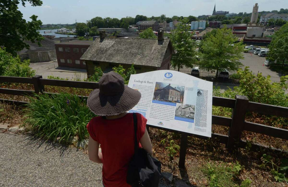Westport resident Mary Luvera looks at the new signage as The Norwalk Historical Society celebrates the grand re-opening of the Mill Hill Historic Park Saturday, June 10, 2017, in Norwalk, Conn. The event was held in conjunction with the state of Connecticut's, CT Open House Day 2017, a celebration of the state's art, history and tourism.