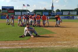 Albany Academy's Ben Seiler deals with the disappointment of a seventh-inning loss as Livonia celebrates winning the Class B baseball state title in the background on Saturday, June 10, 2017, at NYSEG Stadium in Binghamton. (Pete Dougherty / Times Union)