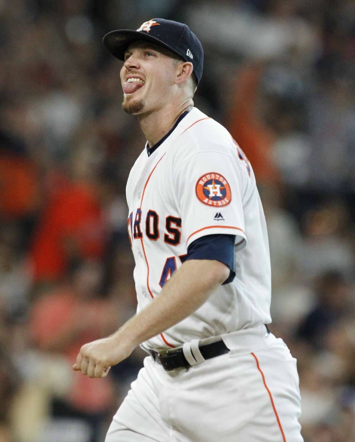Houston Astros relief pitcher Chris Devenski (47) sticks his tongue out to cheer striking out a Los Angeles Angels player and finishing the bottom eighth inning at Minute Maid Park Saturday, June 10, 2017, in Houston. The Astros defeated Los Angeles Angels 3-1. ( Yi-Chin Lee / Houston Chronicle )