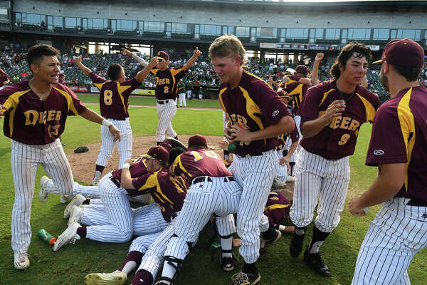 The Deer Park Deer, inlcluding senior shortstop Josiah Ortiz (13), junior Connor Williams, center, and senior pitcher Clay Aguilar (9) celebrate their 7-2 win over San Antonio Reagan in their 2017 Class 6A UIL Baseball State Championship final matchup at Dell Diamond in Round Rock on Saturday, June 10, 2017. (Photo by Jerry Baker/Freelance)