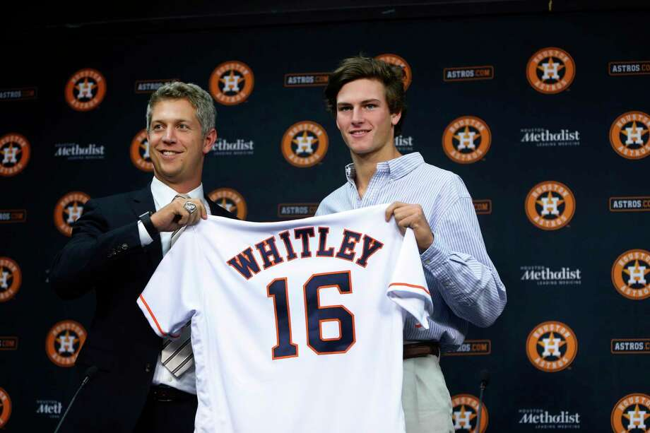 Assistant general manager Mike Elias, left, will help determine whom the Astros will select with the No. 15 overall pick a year after taking righthander Forrest Whitley with the 17th pick. Photo: Karen Warren, Staff / © 2016 Houston Chronicle