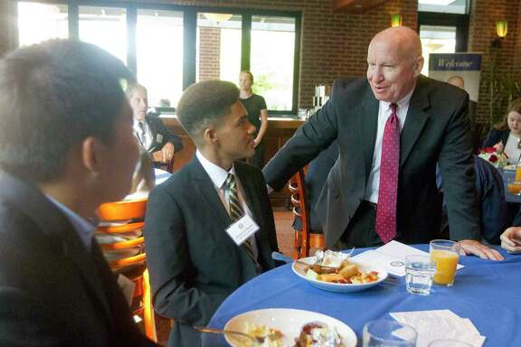U.S. Congressman Kevin Brady, R-The Woodlands, speaks with Broderick Moore and Kyu Oh during Brady's annual academy send off breakfast to celebrate seven local students from the 8th Congressional District who received military appointments to various service academies and preparatory schools at Black Walnut CafŽ, Saturday, June 10, 2017, in The Woodlands. Moore, a recent graduate of The Woodlands, will attend West Point, while Oh, College Park, will attend the Merchant Marine Academy.