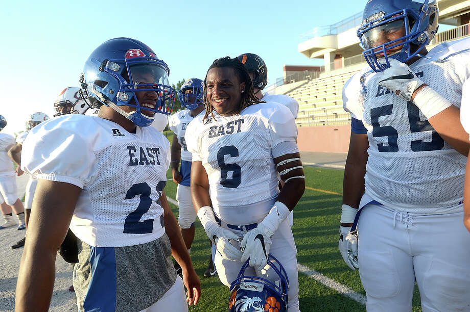 Members of the East team joke with one another as they take in the game action with West during the All Star football match-up at the Thomas Center Saturday night. Photo taken Saturday, June 10, 2017 Kim Brent/The Enterprise Photo: Kim Brent / BEN