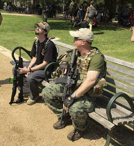 A number of protesters, many armed with guns and wearing camouflage or makeshift armor, rallied at Hermann Park in Houston on Saturday, June 10, 2017. Carrying Texas and Confederate flags, participants seem concerned that the Sam Houston statue at the park might be removed since the historical figure owned slaves. Photo: Evan Mintz/Houston Chronicle / Houton Chronicle