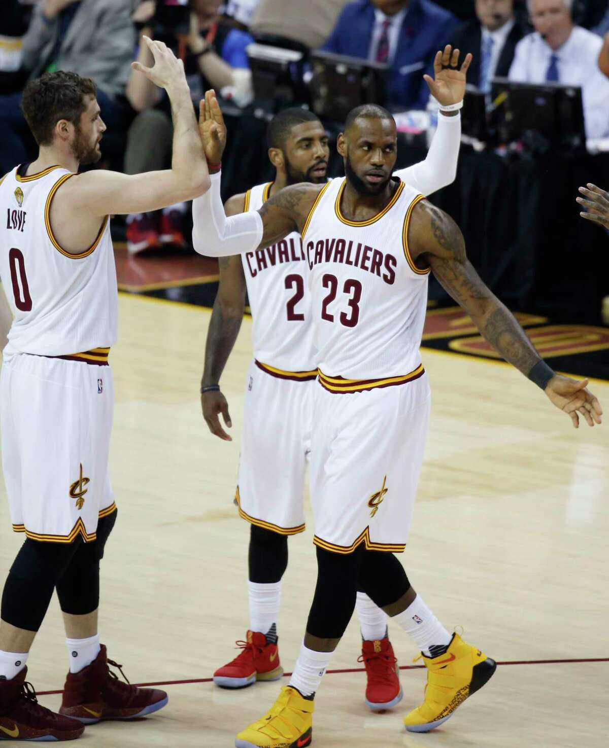 LeBron James (23), Kevin Love (0) and Kyrie Irving live to fight another day after pulling together to help the Cavaliers rout the Warriors 137-116 in Game 4.