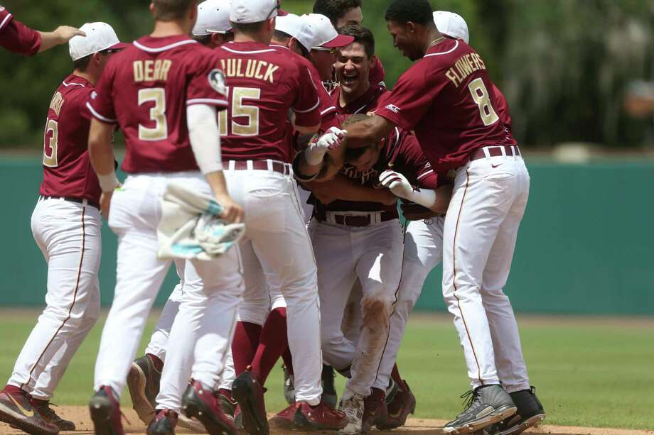 Florida State players mob Jackson Lueck after his walkoff RBI single Saturday lifted the Seminoles by Sam Houston State. Photo: Joe Rondone, MBR / Joe Rondone/Democrat