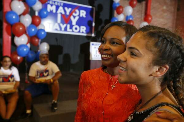 Mayor Ivy Taylor (left) poses for a photo with Ariana Reid at a watch party held Saturday June 10, 2017 at Sunset Station.