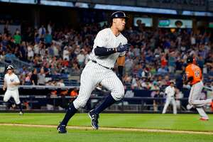 NEW YORK, NY - JUNE 10:  Aaron Judge #99 of the New York Yankees runs out his fifth inning two run double against Edwin Jackson #28 of the Baltimore Orioles as teammate Brett Gardner #11 heads for home at Yankee Stadium on June 10, 2017 in the Bronx borough of New York City.  (Photo by Jim McIsaac/Getty Images)