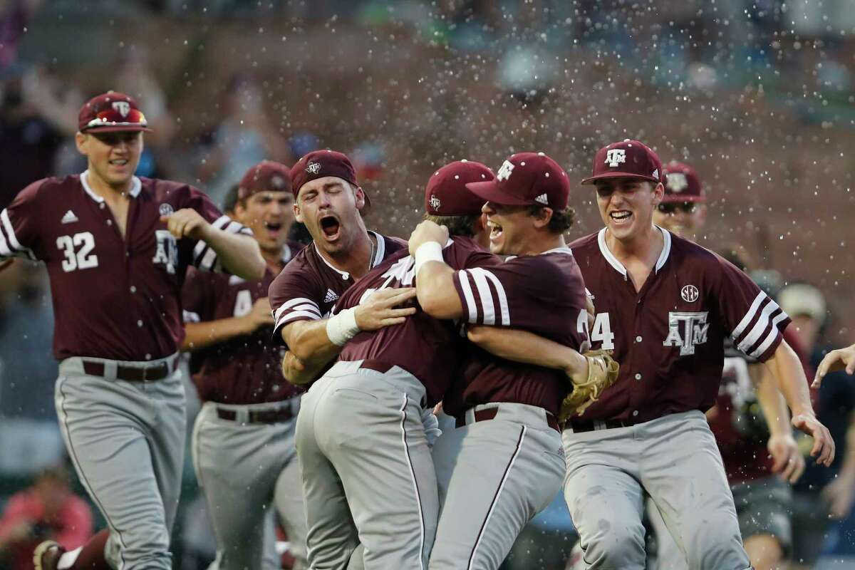 Texas A&M celebrates its first appearance in the College World Series since 2011 after a 12-6 victory over Davidson on Saturday at Blue Bell Park.