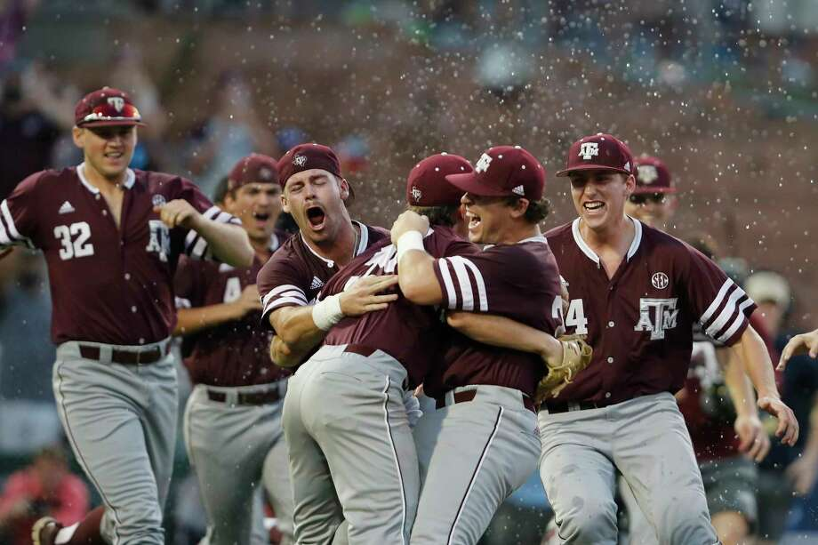 Texas A&M celebrates its first appearance in the College World Series since 2011 after a 12-6 victory over Davidson on Saturday at Blue Bell Park. Photo: Tim Warner, Freelance / Houston Chronicle