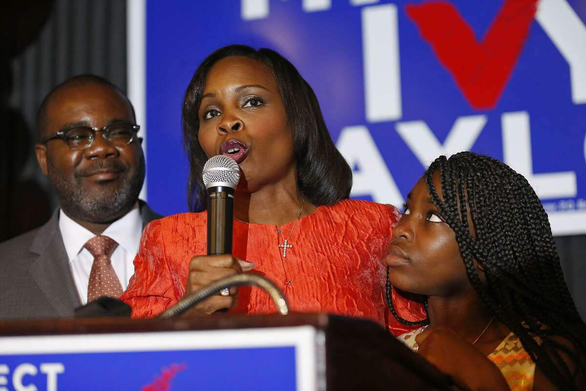 Mayor Ivy Taylor (center) with her husband Rodney Taylor and their daughter Morgan Taylor addresses supporters, at Sunset Station, and concedes the June 10, 2017 runoff election to District 8 Councilman Ron Nirenberg.