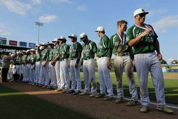 Reagan stands with their silver medals after falling to Deer Park 7-2 during a Class 6A UIL state championship at Dell Diamond in Round Rock, Saturday, June 10, 2017. (Stephen Spillman)