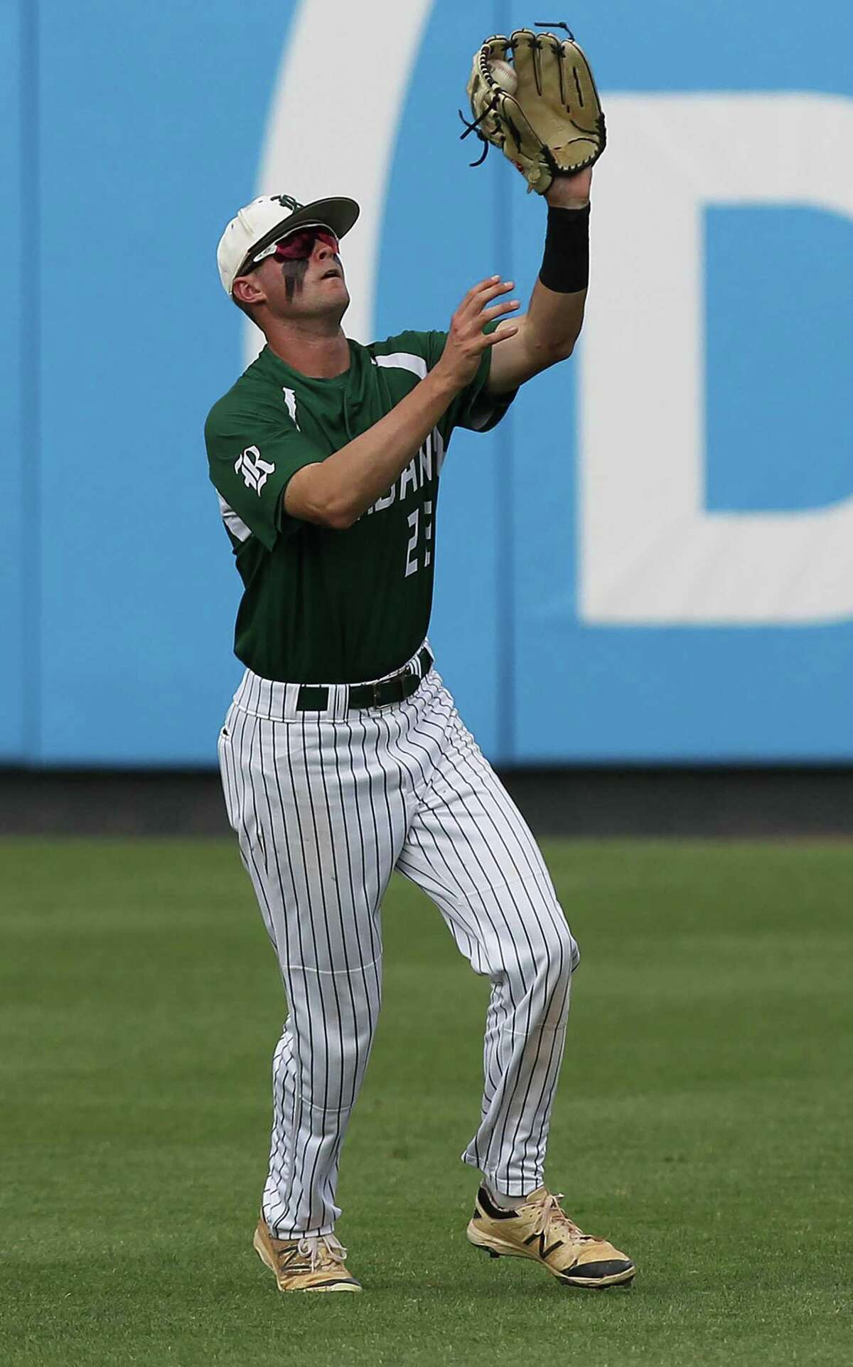 Reagan's Cade Bormet makes the catch in center field against Deer Park during the Class 6A UIL state championship at Dell Diamond in Round Rock on June 10, 2017.