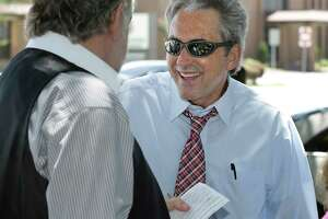 Jeff Wagner, a mayoral candidate in the Pasadena election runoff, engages a voter outside City Hall earlier this week.