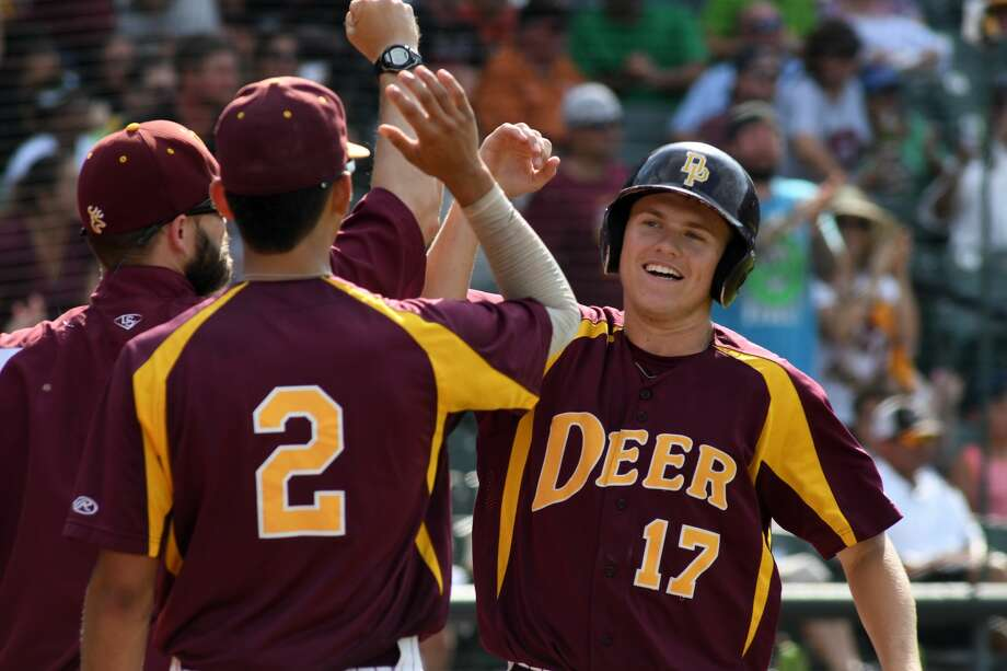 Deer Park sophomore Jordan Phillips (17) is greeted by teammate Mark Barrow (2) after he scores against San Antonio Reagan in the top of the 4th inning of their 2017 Class 6A UIL Baseball State Championship final against San Antonio Reagan at Dell Diamond in Round Rock on Saturday, June 10, 2017. (Photo by Jerry Baker/Freelance) Photo: Jerry Baker/For The Chronicle