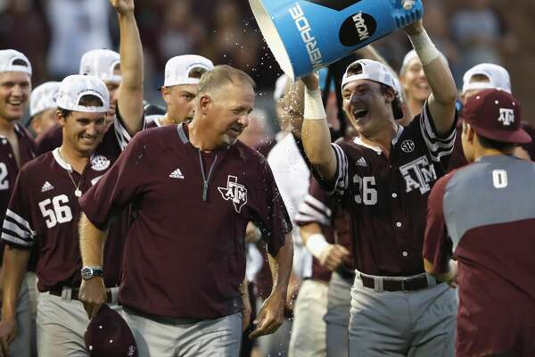 Texas A&M head coach Rob Childress gets away from the water bucket pour by catcher Blaine Schoenvogel (36) after the 2017 NCAA Super Regional baseball game between the Davidson Wildcats and the Texas A&M Aggies at Blue Bell Park on Saturday, June 10, 2017, in College Station, TX.