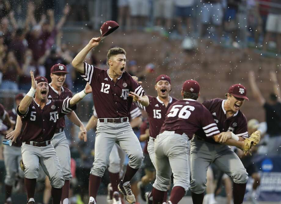 Texas A&M pitcher Corbin Martin (12) and the team celebrate after the final out of the the 2017 NCAA Super Regional baseball game between the Davidson Wildcats and the Texas A&M Aggies at Blue Bell Park on Saturday, June 10, 2017, in College Station, TX. Photo: Tim Warner/For The Chronicle