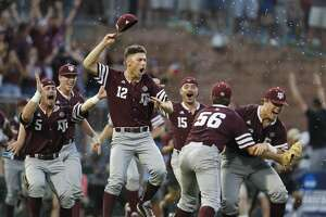 Texas A&M pitcher Corbin Martin (12) and the team celebrate after the final out of the the 2017 NCAA Super Regional baseball game between the Davidson Wildcats and the Texas A&M Aggies at Blue Bell Park on Saturday, June 10, 2017, in College Station, TX.