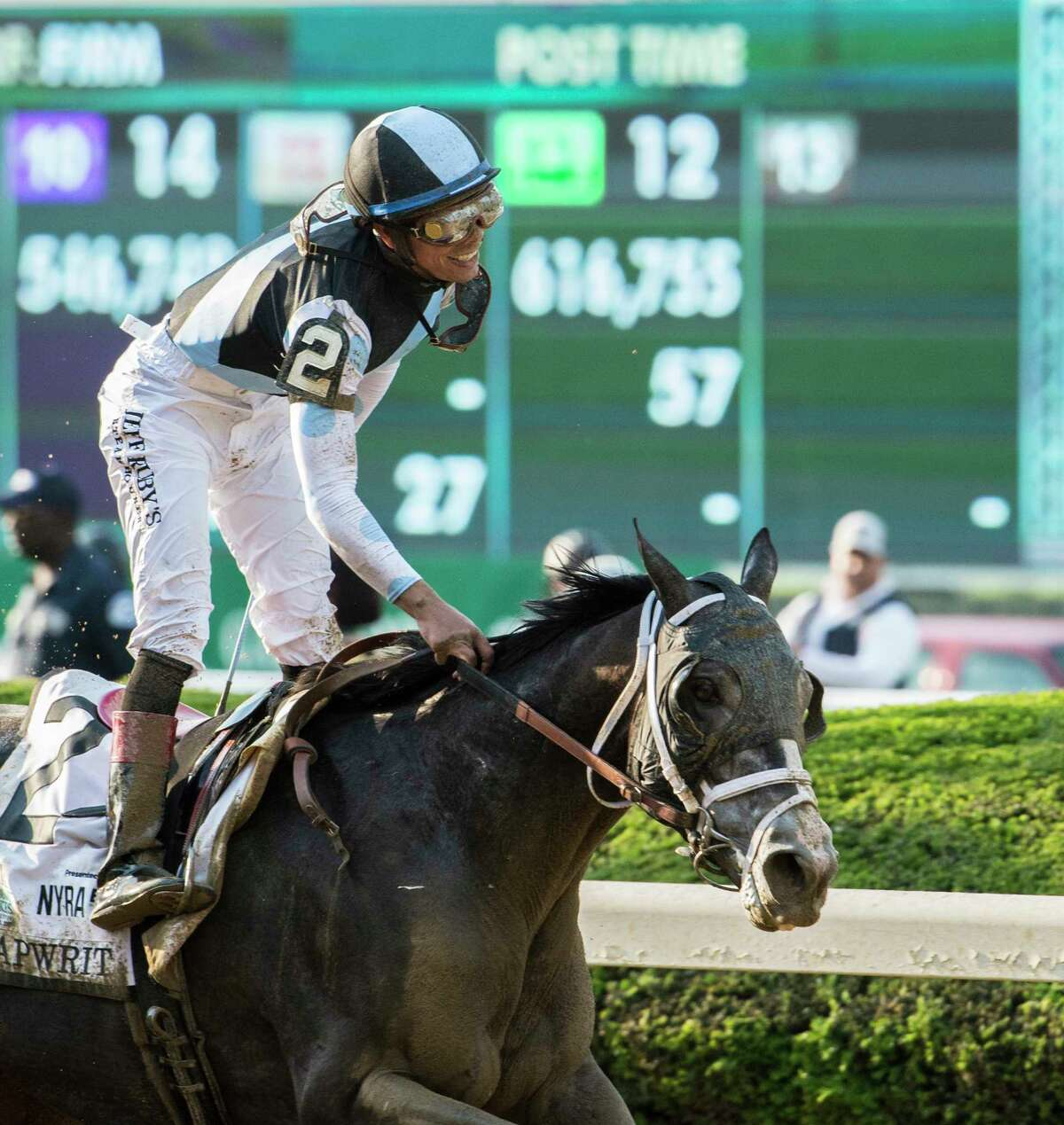 Jockey Jose Ortiz is all smiles after ridding Tapwrit to the win in the 149th running of the Belmont Stakes at Belmont Park June 10, 2017 in Elmont, N.Y. (Skip Dickstein/Times Union)