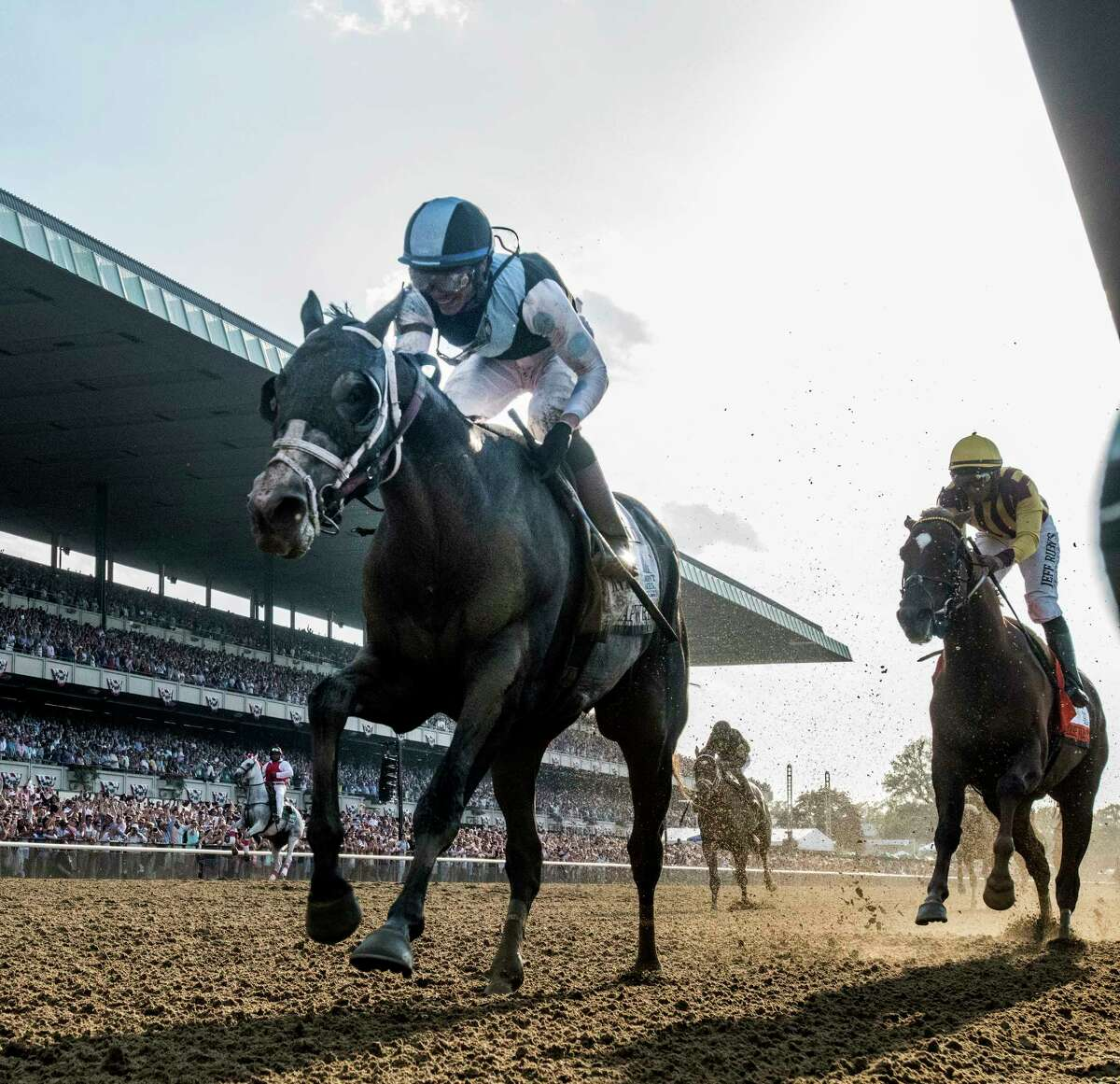 Tapwrit ridden by Jose Ortiz, left passes Irish War Cry ridden by Rajiv Maragh to the win in the 149th running of the Belmont Stakes at Belmont Park June 10, 2017 in Elmont, N.Y. (Skip Dickstein/Times Union)