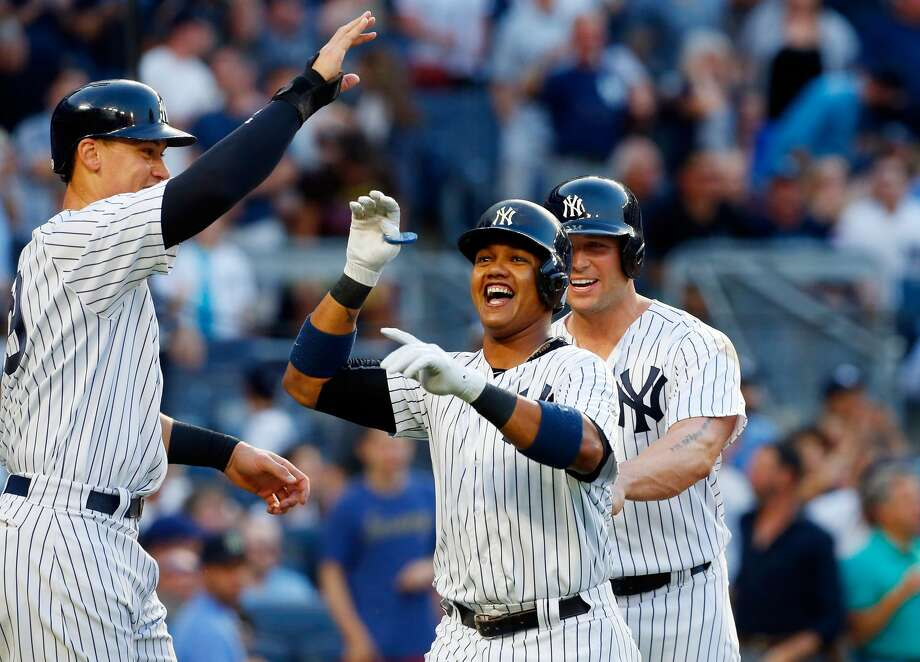 NEW YORK, NY - JUNE 10:  Starlin Castro #14 of the New York Yankees celebrates his second inning three run home run against the Baltimore Orioles with teammates Aaron Judge #99 and Matt Holliday #17 at Yankee Stadium on June 10, 2017 in the Bronx borough of New York City.  (Photo by Jim McIsaac/Getty Images) Photo: Jim McIsaac/Getty Images
