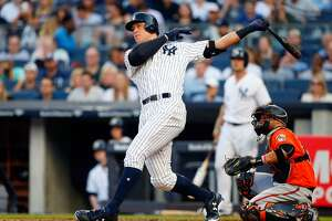 NEW YORK, NY - JUNE 10:  Aaron Judge #99 of the New York Yankees follows through on a first inning home run against the Baltimore Orioles at Yankee Stadium on June 10, 2017 in the Bronx borough of New York City.  (Photo by Jim McIsaac/Getty Images)