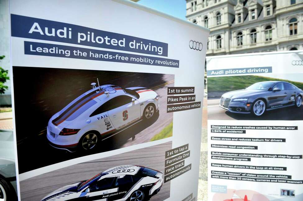 A view of some of the informational signs on display near the Audi A7 piloted driving prototype vehicle on Monday, May 23, 2016, in Albany, N.Y. Employees of the auto maker were outside the Capitol to talk with legislators about the driverless car. The State Senate is scheduled to vote on a bill that would advance self-driving technologies in New York State. (Paul Buckowski / Times Union)