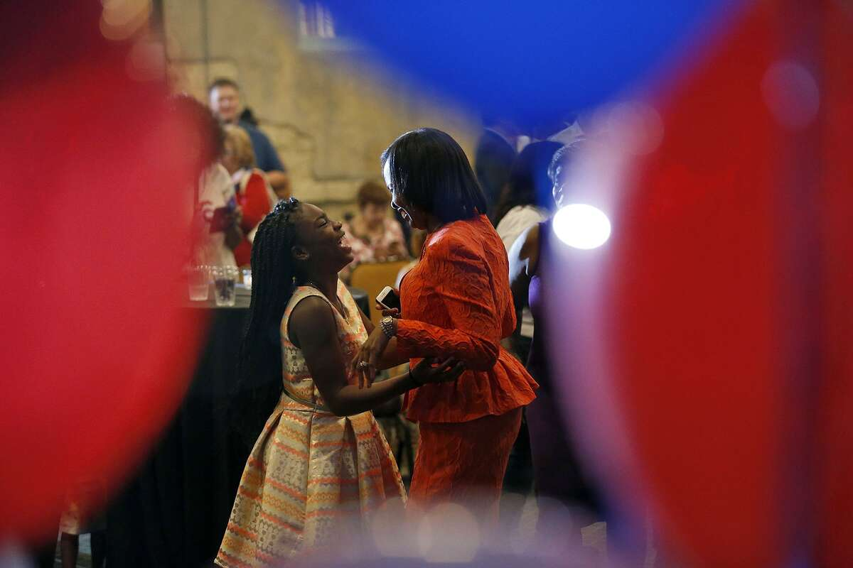 Mayor Ivy Taylor dances with her daughter Morgan Taylor, at Sunset Station, after conceding the June 10, 2017 runoff election to District 8 Councilman Ron Nirenberg.