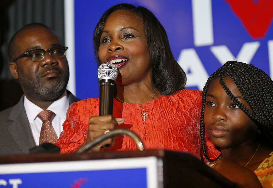 Mayor Ivy Taylor (center) with her husband Rodney Taylor  and their daughter Morgan Taylor addresses supporters, at Sunset Station, and concedes the June 10, 2017 runoff election to District 8 Councilman Ron Nirenberg. Photo: Edward A. Ornelas, Staff / San Antonio Express-News / © 2017 San Antonio Express-News