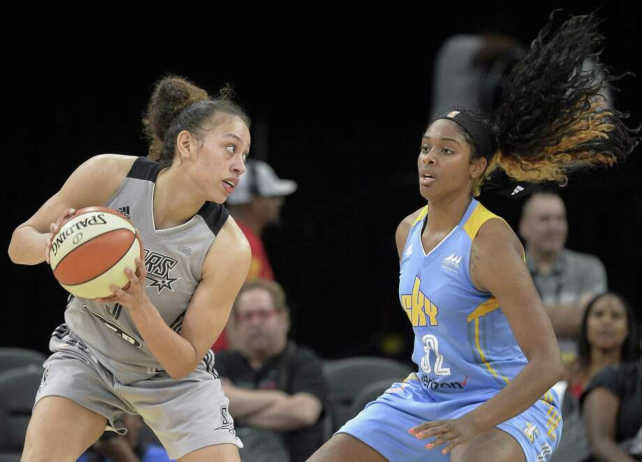 San Antonio Stars forward Dearica Hamby, left, tangles with Chicago Sky forward Cheyenne Parker during the second half of a WNBA basketball game, Saturday, June 10, 2017, in San Antonio. Chicago won 85-81 in overtime. (Darren Abate/For the Express-News) Photo: Darren Abate, FRE / San Antonio Express-News / Darren Abate