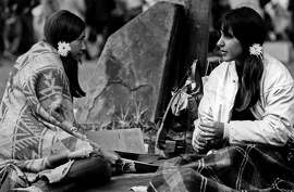 """ADVANCE FOR USE TUESDAY, JUNE 13, 2017 AND THEREAFTER- In this June 17, 1967 photo are two women at the Monterey Pop Festival in Monterey, Calif. Before Burning Man and Bonnaroo, Coachella and Lollapalooza, Glastonbury and Governors Island, there was Monterey Pop. Fifty years ago in June 2017, the three-day concert in the San Francisco Bay area gave birth to the """"Summer of Love'' and paved the way for today's popular festivals. (Monterey Herald via AP)"""