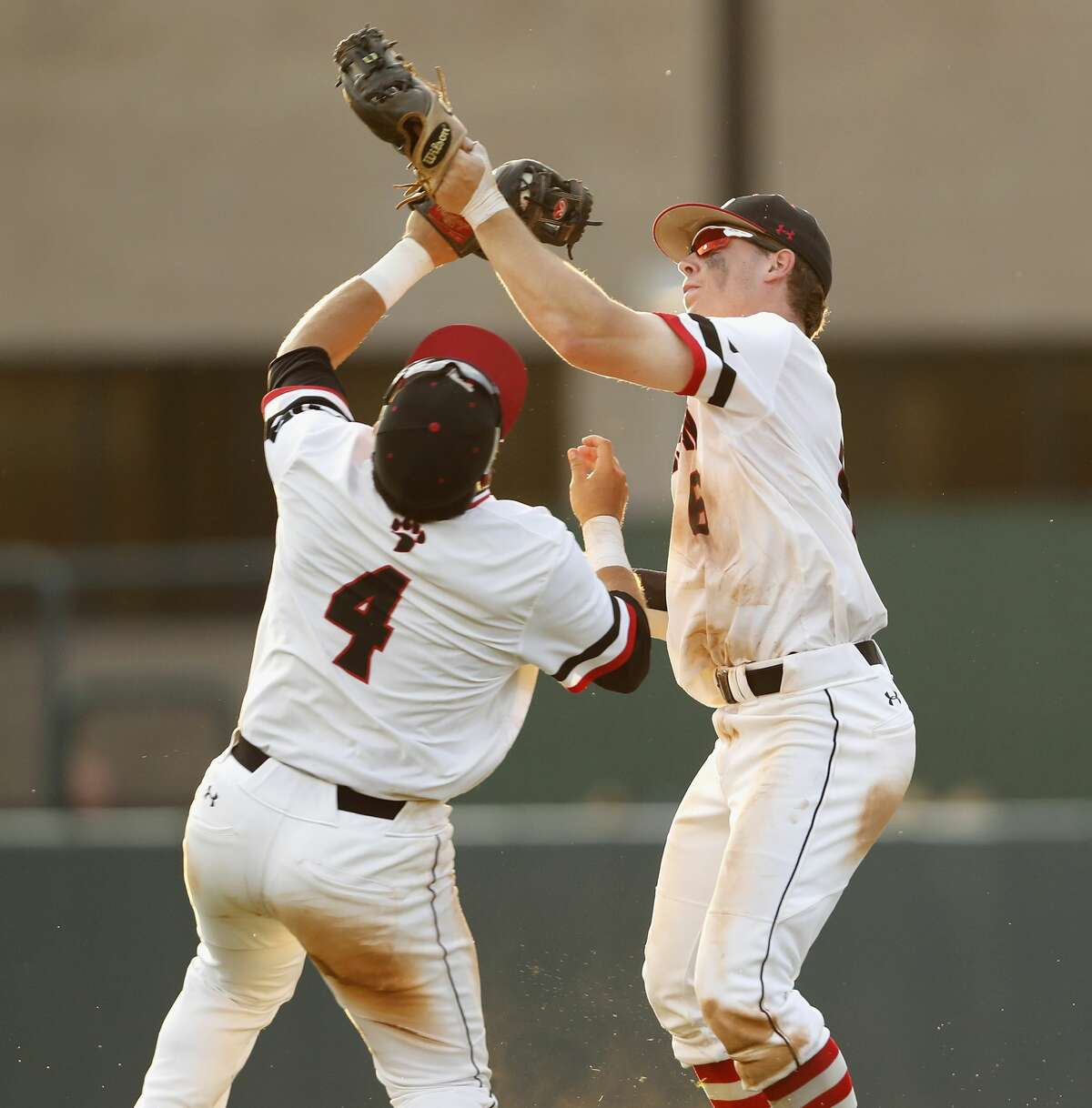 Davidson catcher Eric Jones (6) and shortstop Alec Acosta (4) collide attempting to catch a fly ball in the eighth inning during the 2017 NCAA Super Regional baseball game between the Davidson Wildcats and the Texas A&M Aggies at Blue Bell Park on Saturday, June 10, 2017, in College Station, TX.