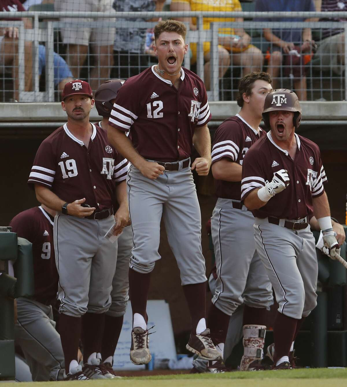 Texas A&M pitcher Corbin Martin (12) celebrates with teammates after an error in the eighth inning that scored a run during the 2017 NCAA Super Regional baseball game between the Davidson Wildcats and the Texas A&M Aggies at Blue Bell Park on Saturday, June 10, 2017, in College Station, TX.