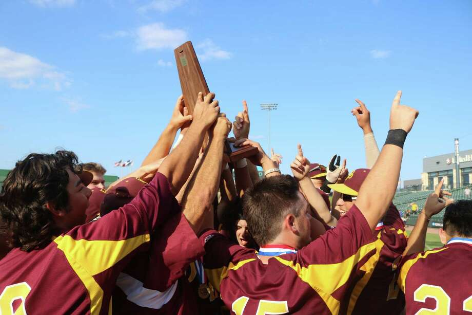The newly-crowned Class 6A state champs hold aloft the symbol of that title, the UIL's state championship trophy. Photo: Robert Avery