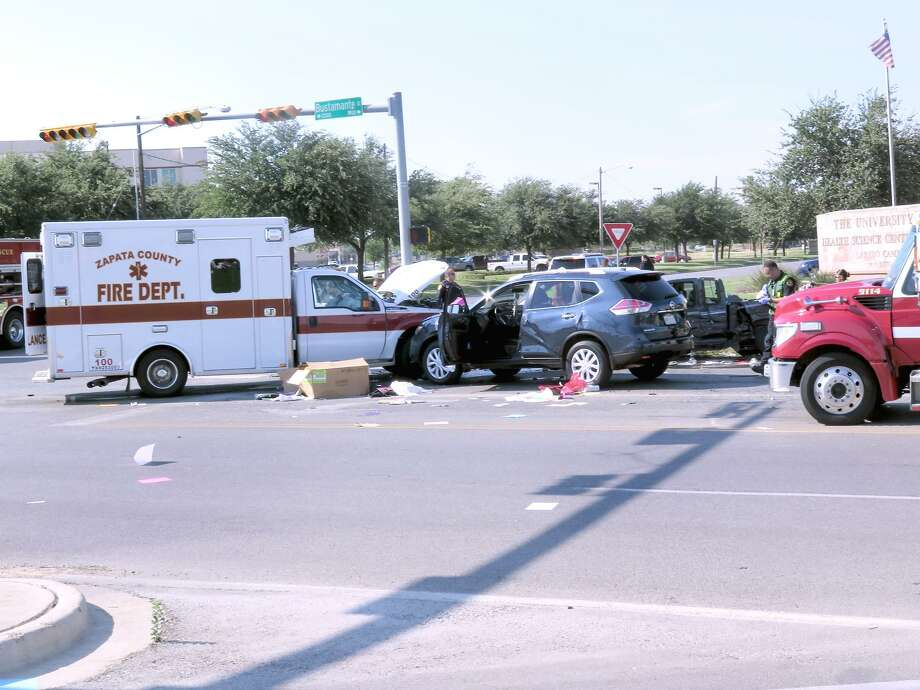 A Zapata County Fire Department ambulance, transporting a pregnant woman, was part of a three-vehicle collision at the intersection of Bustamante Street and Bartlett Avenue on Friday. Photo: Cuate Santos /Laredo Morning Times / Laredo Morning Times