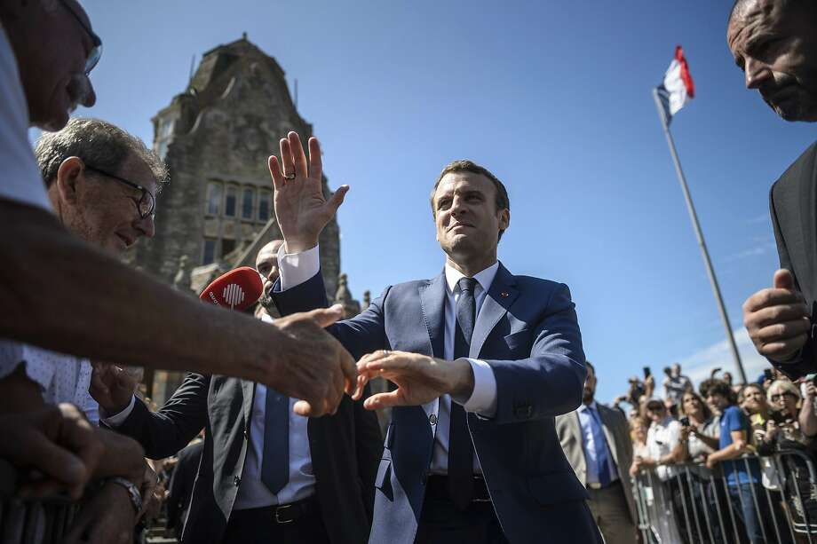 Macron party claims parliamentary victory