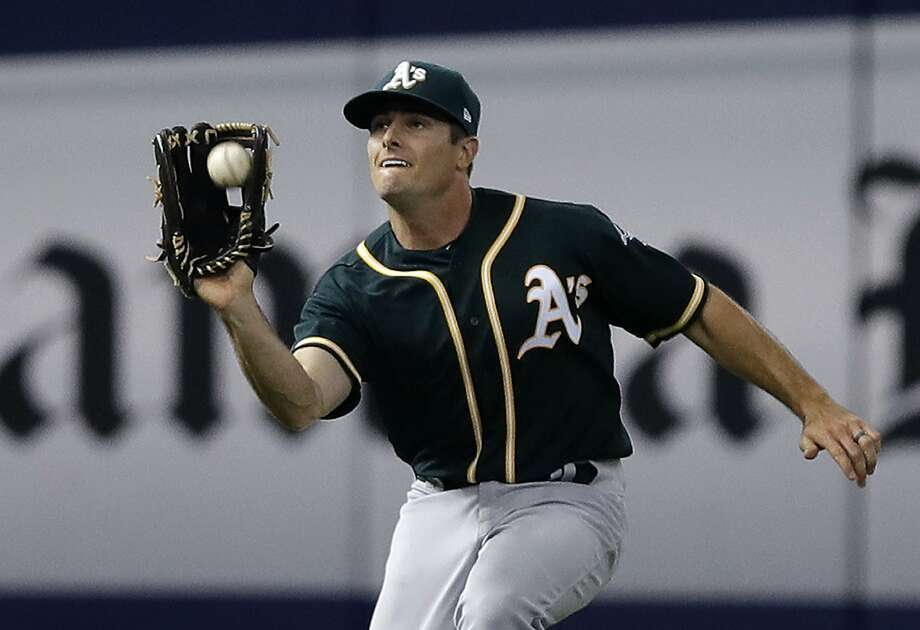 Oakland Athletics left fielder Jaycob Brugman makes a running catch on a fly ball byTampa Bay Rays' Taylor Featherston during the eighth inning of a baseball game Friday, June 9, 2017, in St. Petersburg, Fla. Brugman made his debut in the majors with the game. (AP Photo/Chris O'Meara) Photo: Chris O'Meara, Associated Press