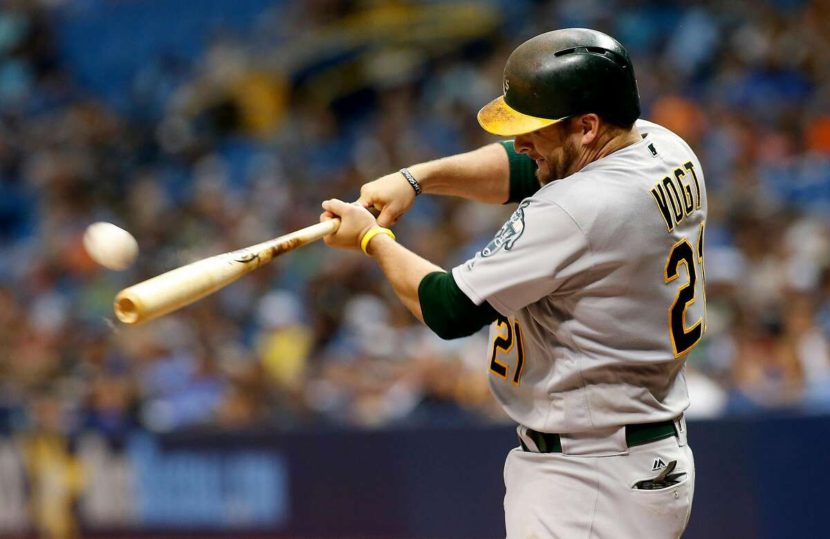 Stephen Vogt of the Oakland Athletics hits an RBI double off of pitcher Chris Archer of the Tampa Bay Rays to score Yonder Alonso during the fourth inning of a game on June 11, 2017 at Tropicana Field in St. Petersburg, Florida.