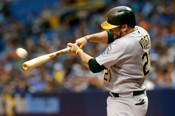 ST. PETERSBURG, FL - JUNE 11:  Stephen Vogt #21 of the Oakland Athletics hits an RBI double off of pitcher Chris Archer of the Tampa Bay Rays  to score Yonder Alonso during the fourth inning of a game on June 11, 2017 at Tropicana Field in St. Petersburg, Florida. (Photo by Brian Blanco/Getty Images)