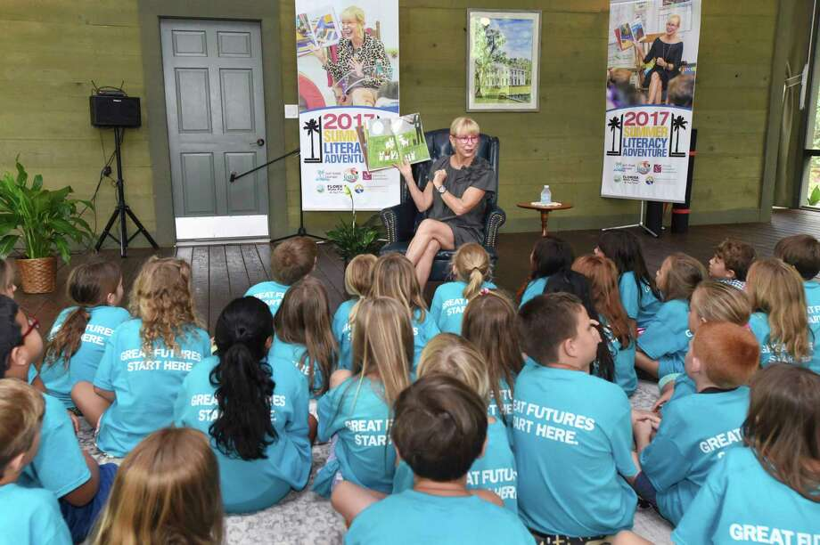 """Florida first lady Ann Scott, wife of Florida Gov. Rick Scott, reads the children's book """"Antoinette"""" to a group of children from the Boys and Girls Club of the Emerald Coast June 6, 2017, at Eden Gardens State Park, located in south Walton County in the Florida panhandle. Scott read the book and visited with the children to promote the Florida Department of Education's summer reading program, Summer Literacy Adventure. (Devon Ravine/Northwest Florida Daily News via AP) Photo: Devon Ravine, MBI / Northwest Florida Daily News"""