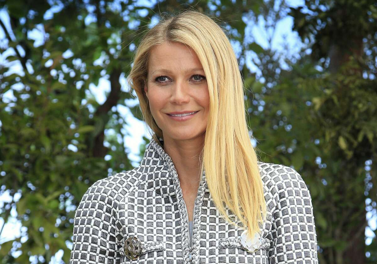 FILE - In this Jan. 26, 2016, file photo, Gwyneth Paltrow poses for photographers before Chanel's Spring-Summer 2016 Haute Couture fashion collection in Paris. Paltrow's controversial lifestyle and wellness company, Goop, has agreed to refund some customers who purchased its vaginal eggs and pay out $145,000 in consumer-protection lawsuit settlement, California prosecutors announced this week.