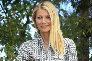 """FILE - In this Jan. 26, 2016, file photo, Gwyneth Paltrow poses for photographers before Chanel's Spring-Summer 2016 Haute Couture fashion collection in Paris. Paltrow hosted the inaugural """"In Goop Health"""" event Saturday, June 10, 2017, in Culver City, California, where about 600 women spent the day chatting, learning, eating, shopping and generally indulging in the designer-wellness lifestyle touted by goop.com. (AP Photo/Thibault Camus, File)"""