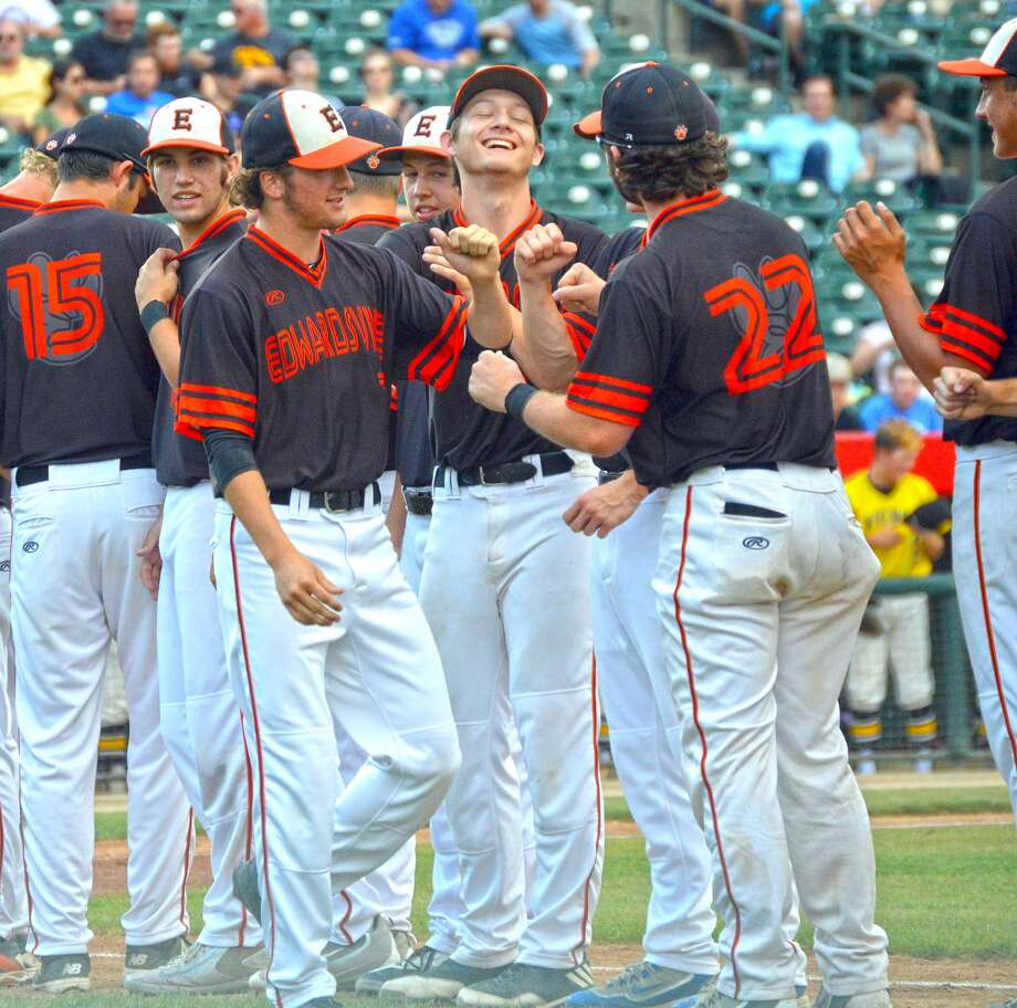 Edwardsville's Kade Burns makes his way down the line as the Tigers players are introduced prior to Friday's game.