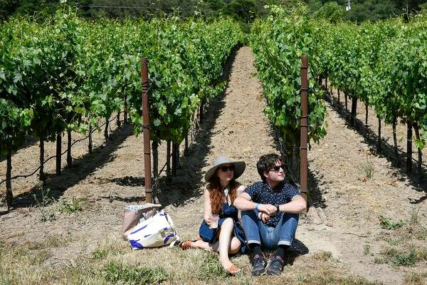 Lori Kitching and Adam Dweck relax in the vineyard during the 2017 Huichica Music Festival held at Gundlach Bundschu Winery in Sonoma, CA, on Saturday June 10, 2017.