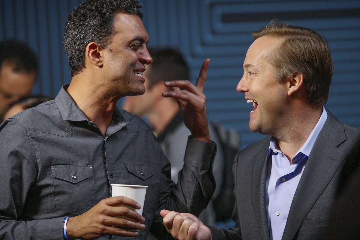 Emil Michael, Uber's senior vice president of business, left, chats with colleagues and friends, Wednesday, June 3, 2015, at the Uber headquarters in San Francisco, Calif. The company's CEO Travis Kalanick gave a speech at Uber's five-year anniversary event.