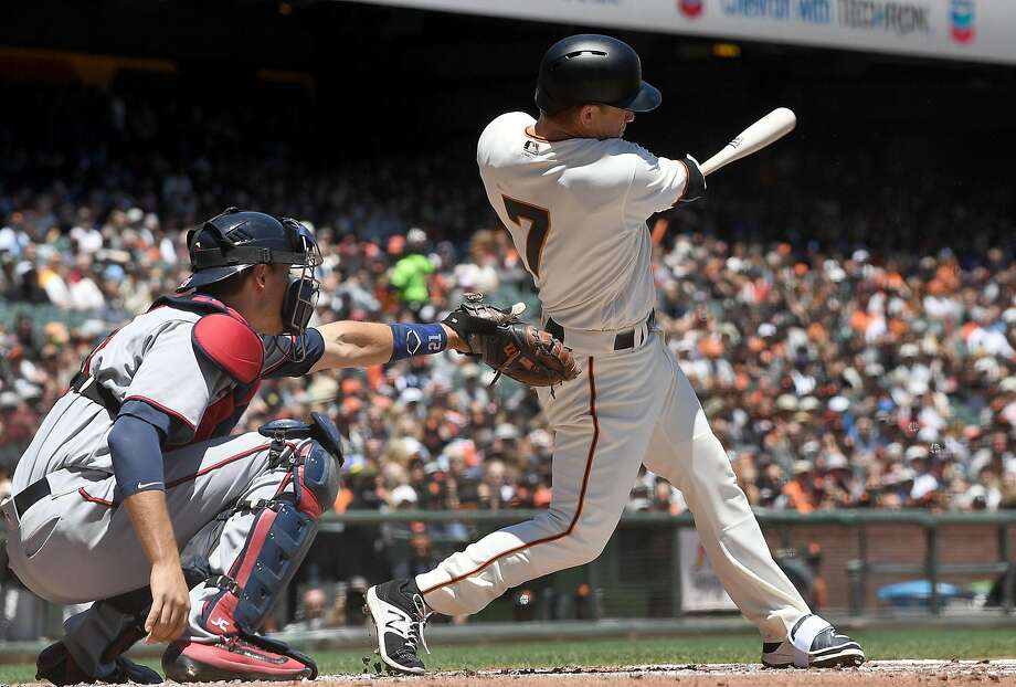 Aaron Hill of the San Francisco Giants hits a sacrifice fly ball scoring Kelby Tomlinson against the Minnesota Twins in the bottom of the first inning at AT&T Park on June 11, 2017 in San Francisco, California.  (Photo by Thearon W. Henderson/Getty Images) Photo: Thearon W. Henderson, Getty Images