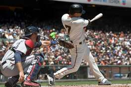 SAN FRANCISCO, CA - JUNE 11:  Aaron Hill #7 of the San Francisco Giants hits a sacrifice fly ball scoring Kelby Tomlinson #37 against the Minnesota Twins in the bottom of the first inning at AT&T Park on June 11, 2017 in San Francisco, California.  (Photo by Thearon W. Henderson/Getty Images)