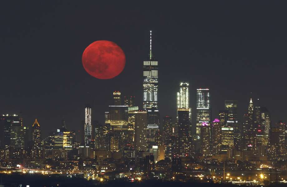The moon rises above lower Manhattan and One World Trade Center in New York City on June 10, 2017, as seen from West Orange, NJ. Photo: Gary Hershorn/Getty Images