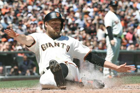 SAN FRANCISCO, CA - JUNE 11:  Hunter Pence #8 of the San Francisco Giants scores against the Minnesota Twins in the bottom of the fourth inning at AT&T Park on June 11, 2017 in San Francisco, California.  (Photo by Thearon W. Henderson/Getty Images)