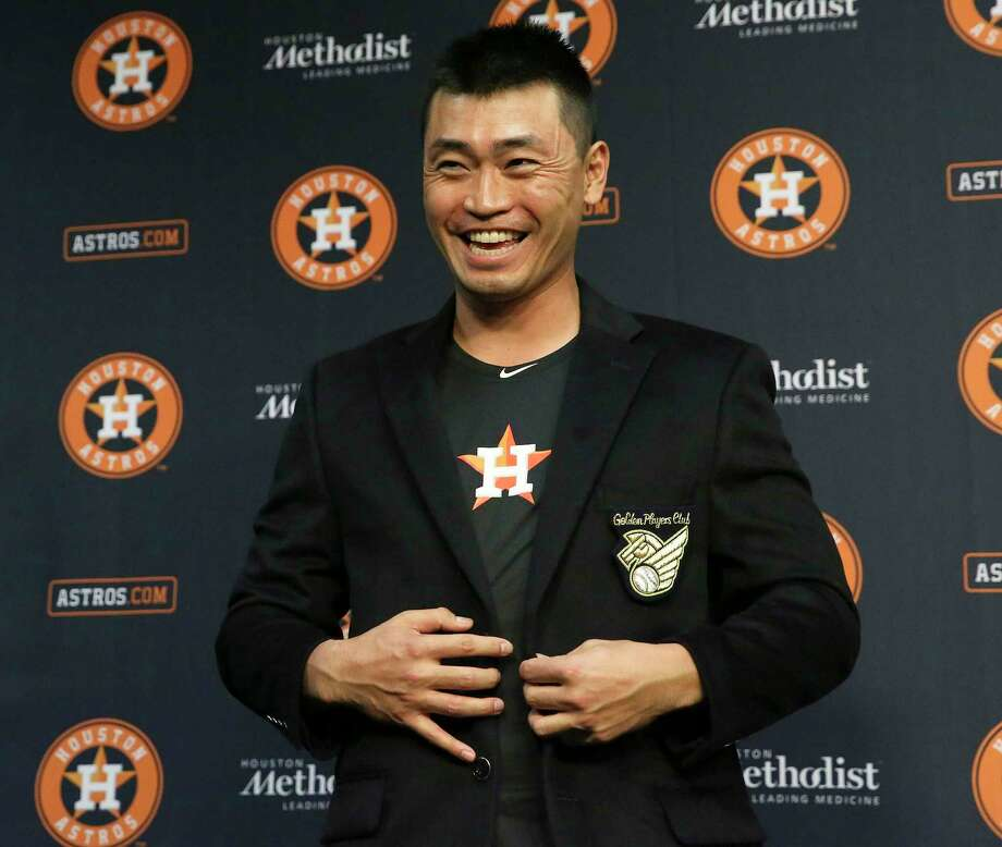 Houston Astros' Norichika Aoki (3) puts on his Golden Players Club jacket from the Golden Ball Players association to honor his 2000th hit between his careers in Nippon Professional Baseball and Major League Baseball Sunday, June 11, 2017, in Houston. Photo: Yi-Chin Lee / © 2017  Houston Chronicle